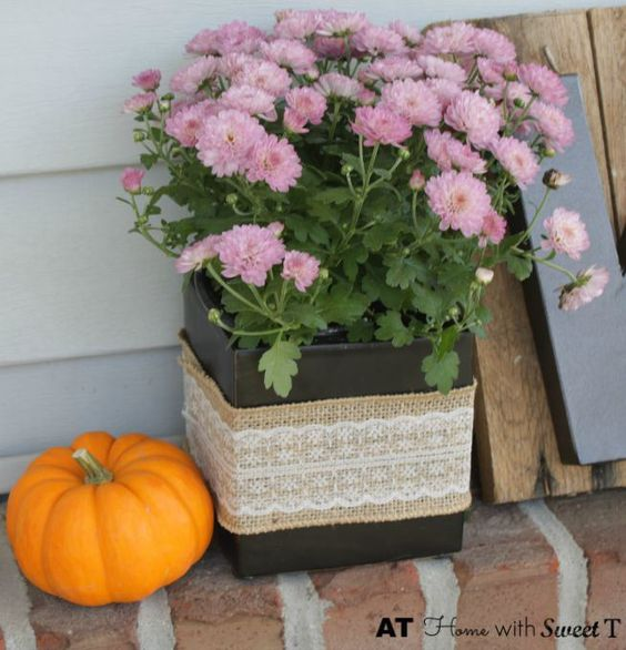 burlap vase with yellow mums fall porch
